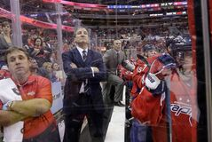 Washington Capitals coach Adam Oates, center, puts a foot on the bench to get a better view of the action, next to assistant coach Tim Hunter, second from left, in the third period of an NHL hockey game against the Toronto Maple Leafs in Washington on Feb. 5, 2013. With three coaches in the past two seasons, the Washington Capitals' only measure of consistency has been change. But amid the adjustments that came with yet another coach and system this season, the Capitals were quick to embrace Adam Oates' philosophy. THE CANADIAN PRESS/AP - Alex Brandon