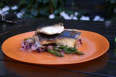Crispy skin sea bass with sauteed vegetables and lemon butter sauce is shown in this recent handout photo. Escaping the city for a few days of camping doesn't have to mean getting away from delicious food, says a chef who takes pleasure in elevating his menu from those old standbys, burgers and hot dogs. Marcus Monteiro, who grew up camping with his family near Bobcaygeon in the Kawartha Lakes area of Ontario, still enjoys roughing it under canvas. But when it comes to his food, the executive chef at Brassaii Restaurant and Lounge in Toronto prefers to create easy, healthful and tasty alternatives to the packaged and processed fare that many tote along for their outdoor experience. THE CANADIAN PRESS/HO - Canadian Tire