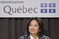 Justice France Charbonneau smiles as she sits on the opening day of a Quebec inquiry looking into allegations of corruption in the province's construction industry in Montreal, Tuesday, May 22, 2012. The inquiry is set to resume today after an extended holiday break. THE CANADIAN PRESS/Graham Hughes