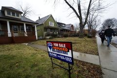 Home that are reduced in prices in a once vibrant city of Windsor, Ont., on Thursday, January 26, 2012. Windsor was one of the worst hit Ontario cities during the last recession. THE CANADIAN PRESS/Nathan Denette