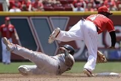 San Francisco Giants' Pablo Sandoval slides hard past Cincinnati Reds second baseman Brandon Phillips (4) trying to break up a double play at second base in the fifth inning of a baseball game, Thursday, June 5, 2014, in Cincinnati. Phillips thre Michael Morse out at first to complete the double play. (AP Photo/Al Behrman)