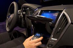 CUE, Cadillac's new touch-based, in-dash entertainment control system.