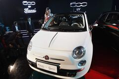 A Chinese woman looks at Fiat 500 co-designed with fashion house Gucci.