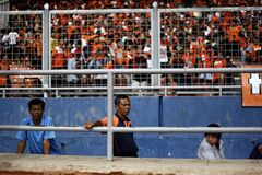 In this Sunday, Jan. 6, 2013 photo, fans watch a soccer match between Jakarta's Persija against Samarinda's Persisam at Gelora Bung Karno Stadium in Jakarta, Indonesia. Soccer is the most loved sport by far in this nation of 240 million people, but a feud over control of the sport by two politically-connected business factions cause problems: there are two rival leagues, a national side where the best players are banned or unwilling to join, bankrupt teams, fleeing sponsors, allegations of rampant match-fixing and irregularities, widespread corruption and organizational chaos. (AP Photo/Dita Alangkara)