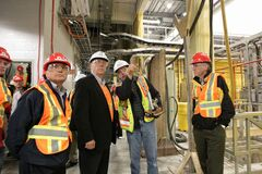 Dave Chomiak, left, minister responsible for Manitoba Hydro and Premier Greg Selinger get an explanation of the inner workings of the Wuskwatim Generating Station from construction manager Terry Armstrong (second from right) while minister Steve Ashton (right) looks on.