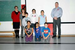 Burrows MLA Melanie Wight (far left) and Winnipeg Police Association president Mike Sutherland present Kent Road School staff and students with funding for their kindness initiative through the Cool 2Be Kind campaign. The presentations were made on Nov. 19 at Kent Road School.  Back row: Wight, Brenda Ryant (Kent Road School counsellor), Isaiah Mentuck, Gabriella Swampy, Trisiti� Hall-Probizanski, Sutherland. Front row: Deshyra Julian, Sydney Dacanay, Cole Lander.