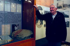 Transcona resident Paul Martin looks at the Transcona Historical Museum display containing a telegram he wrote on D-Day. The museum's Love Letters to Transcona exhibit opened on March 21.