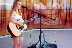 Windsor Park resident Mikayla Zacharias performs a tune during the Transcona BIZ Market Garden opening at the Transcona Centennial Square on July 4.