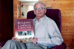 Peter McCarthy, who will be honoured with a Mayor's Volunteer Service Award later this month, is shown with a book commemorating the Jimmy Carter Work Project for Habitat for Humanity, one organization where McCarthy spent countless hours.