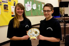 John Pritchard Grade 8 band students Emily Auch and Alasdair de Koning are shown with the five-star plaque the band earned at the Optimist International Concert Band Festival in February.