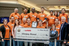 The Association of Professional Engineers and Geoscientists of the Province of Manitoba presents a cheque to Winnipeg Harvest to cover the cost of 12,305 pounds of spaghetti at Kildonan Place on March 9. The Grant Park-based organization generated that total through its Spaghetti Bridge Building Competition, as the entries in the contest bore 12,305 pounds of weight. Canada Safeway and Peak of the Market matched the donation.