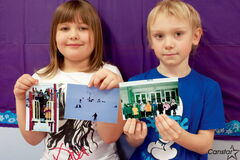 Wayoata School students Nieve Wesa and Nico Klassen display some photos their Grade 1/2 class is submitting to the Transcona Historical Museum for its Love Letters to Transcona exhibit.