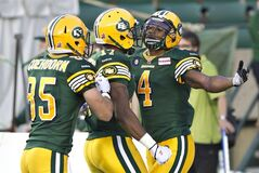 Edmonton Eskimos' Nate Coehoorn (85), Shamawd Chambers (17) and Adarius Bowman (4) celebrate a touchdown against the Ottawa Redblacks during second half action in Edmonton, Alta., on Friday July 11, 2014. They're the talk of the CFL and easily the league's biggest early season surprises.The Eskimos visit the Winnipeg Blue Bombers on Thursday night with both clubs sporting 3-0 records. THE CANADIAN PRESS/Jason Franson.