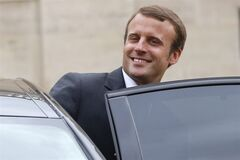 France's new Economy Minister Emmanuel Macron, enter his car as he leaves after the weekly cabinet meeting in Paris, Wednesday, Aug. 27, 2014. France's prime minister reshuffled his Cabinet on Tuesday to silence ministers who had openly criticized Socialist President Francois Hollande's economic policies as he tries to pull the nation out of stagnation and steer it toward growth. (AP Photo/Christophe Ena)