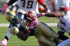 Calgary Stampeders' Malik Jackson strips the ball from Winnipeg Blue Bombers' Chad Simpson during the first half Saturday. Simpson was the still the best Bomber offensively.