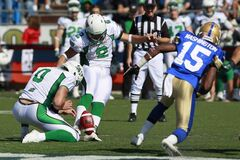 Saskatchewan Roughriders' Sandro DeAngelis (2) kicks the winning field goal in the last seconds of the second half of their CFL game against Winnipeg Blue Bombers in Winnipeg Sunday, September 9, 2012.