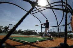 Baltimore Orioles' Chris Davis takes batting practice during the team's first full-squad workout of baseball spring training in Sarasota, Fla., Wednesday, Feb. 19, 2014. (AP Photo/Gene J. Puskar)