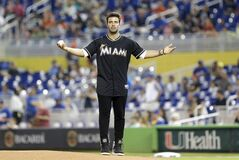 Singer and actor Jencarlos Canela gets the crowd cheering before throwing out a ceremonial first pitch before a baseball game between the Miami Marlins and the Los Angeles Dodgers, Saturday, May 3, 2014, in Miami. (AP Photo/Wilfredo Lee)