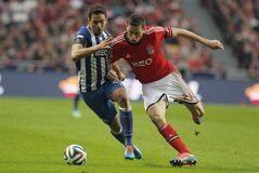 Porto's Carlos Eduardo, left, vies for the ball with Benfica's Nemanja Matic, right, during the Portuguese league soccer match between Benfica and Porto at Benfica's Luz stadium in Lisbon, Sunday, Jan. 12, 2014. (AP Photo/Francisco Seco)