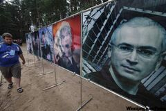 Losers of the Year posters direct scorn at Putin's now-disgraced opponents.