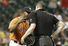 Houston Astros manager Bo Porter, left, argues with home plate umpire Jordan Baker after Astros' Jason Castro was hit by a pitch in the ninth inning of a baseball game against the Oakland Athletics Friday, April 25, 2014, in Houston. Oakland won 12-5. (AP Photo/Pat Sullivan)