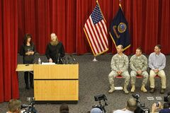 Jani and Bob Bergdahl speak to the media during a press conference at Gowen Field in Boise, Idaho, on Sunday, June 1, 2014. Their son Bowe was freed from captivity Saturday, May 31, 2014, by the Taliban. Also on the stage are Idaho National Guard Public Affairs Officer Col. Tim Marsano, Idaho Army National Guard Maj. Kevin Hickey, and Army Psychologist Dr. (Col) Bradley Kamrowskipoppen. (AP Photo/Otto Kitsinger)