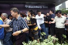 Impatient Indonesians rush to the queue to buy the new BlackBerry 9790 at discounted price for the first 1,000 buyers outside a shopping mall in Jakarta, Indonesia, Friday, Nov. 25, 2011. Thousands of Indonesians jammed into a glitzy shopping mall Friday to get hold of the first BlackBerry Bold 9790s being sold worldwide. (AP Photo/Tatan Syuflana)