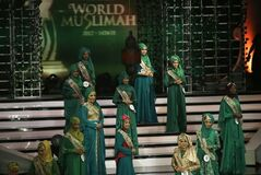 Wednesday, Sept. 18, 2013 photo, contestants line up on the stage during the 3rd Annual Award of World Muslimah, a competition billed as the Islamic alternative to Miss World pageant, in Jakarta, Indonesia. Beauty queens and backstage drama may seem inevitable, but at this year's Miss World competition, something more serious than hair-pulling and name-calling has come from host country Indonesia: Muslim hardliners have threatened to hijack the competition despite major concessions from the government and organizers. (AP Photo/Dita Alangkara)