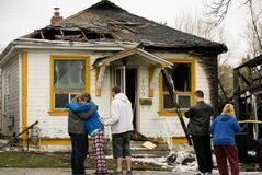 Bradley Larocque and his family outside their fire- and smoke-damaged home.