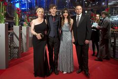 From right, director Richard Linklater, actors Lorelei Linklater, Ellar Coltrane and Patricia Arquette pose for photographers on the red carpet for the film Boyhood during the International Film Festival Berlinale in Berlin, Thursday, Feb. 13, 2014. (AP Photo/Axel Schmidt)