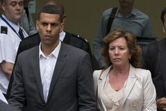 Queens Park Rangers player Anton Ferdinand's mum Janice, right, leaves Westminster Magistrates Courts in London, Friday, July 13, 2012. Chelsea captain John Terry was cleared Friday of racially abusing an opponent, Queens Park Rangers player Anton Ferdinand, during a Premier League match after one of the most high-profile trials involving a soccer player. The case led to Terry being stripped of the England captaincy by the Football Association ahead of the European Championship and the departure of coach Fabio Capello who disagreed with the decision. (AP Photo/Matt Dunham)