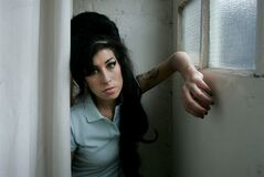 FILE - In this Feb. 16, 2007 file photo, British singer Amy Winehouse poses for a photograph at a studio in north London, Friday, Feb. 16, 2007. Rock 'n' roll will never die, but it's a hazardous occupation. A new study confirms that rock and pop musicians more often die prematurely than the general population, and an early death is twice as likely for solo musicians than for members of bands. (AP Photo/Matt Dunham, File)