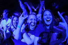 Avid fans watch Iron Maiden perform at the MTS Centre Tuesday.