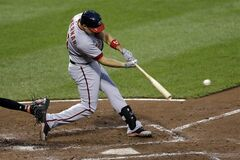 Washington Nationals' Ryan Zimmerman singles in the fourth inning of an interleague baseball game against the Baltimore Orioles, Thursday, July 10, 2014, in Baltimore. Zimmerman reached second, and Anthony Rendon scored on the play. (AP Photo/Patrick Semansky)