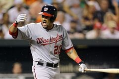Washington Nationals' Ian Desmond reacts after his right arm was hit by a pitch thrown by Baltimore Orioles relief pitcher Darren O'Day in the eighth inning of an interleague baseball game, Thursday, July 10, 2014, in Baltimore. (AP Photo/Patrick Semansky)