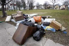 Discarded garbage, furniture and mattresses in a empty lot on Flora Ave. near McGregor Street.