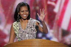 First Lady Michelle Obama waves from the podium during a sound check at the Democratic National Convention in Charlotte, N.C., Monday.