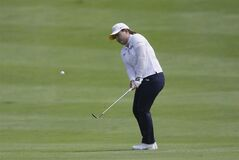 Inbee Park of South Korea hits from the fairway onto the first green during the final round of the Meijer LPGA Classic golf tournament at Blythefield Country Club, Sunday, Aug. 10, 2014, in Belmont, Mich. (AP Photo/Carlos Osorio)