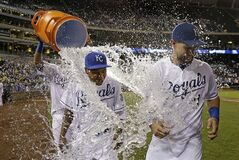 Kansas City Royals' Terrance Gore, left, and Alex Gordon are doused by teammate Salvador Perez after a baseball game against the Texas Rangers, Wednesday, Sept. 3, 2014, in Kansas City, Mo. The Royals won 4-1. (AP Photo/Charlie Riedel)