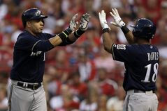Milwaukee Brewers' Aramis Ramirez, left, is congratulated by Khris Davis after hitting a solo home run during the second inning of a baseball game against the St. Louis Cardinals on Friday, Aug. 1, 2014, in St. Louis. (AP Photo/Jeff Roberson)