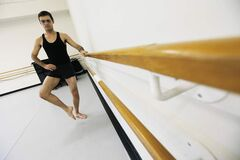 Ian Mozdzen warms up prior to a contemporary dance class at the School of Contemporary Dance.