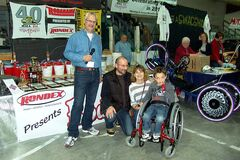 FROM LEFT: MSRA president Chris Jelfs, with Stacey and Daniel Roy and son Teo with his new wheelchair, paid for by the MSRA.