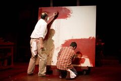 Oliver Becker plays Mark Rothko (in white shirt), and Jameson Matthew Parker plays Ken, in John Logan's Red at the RMTC Warehouse Theatre