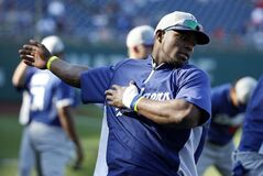 Los Angeles Dodgers right fielder Yasiel Puig, left, stretches during batting practice before a baseball game against the Washington Nationals at Nationals Park, Tuesday, May 6, 2014, in Washington. (AP Photo/Alex Brandon)