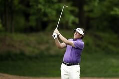 Phil Mickelson watches his approach shot on the 12th hole during the second round of the Wells Fargo Championship golf tournament in Charlotte, N.C., Friday, May 2, 2014. (AP Photo/Chuck Burton)