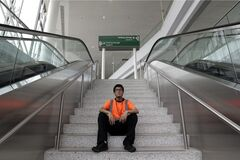 In this photo from Thursday, July 10, 2014, Irwin Carbajal, 23, a aircraft cabin cleaner, poses for a photograph at Newark Liberty International Airport in Newark, N.J. Carbajal, who makes $8.25 an hour, is hoping to benefit from a pay increase which the Service Employees International Union is pushing for. (AP Photo/Julio Cortez)