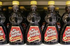 FILE - In a Monday, Feb. 12, 2007, file photo, bottles of Mrs. Butterworth's Original Syrup are displayed in a store, in Princeton, N.J. Hillshire Brands is buying Pinnacle Foods, whose brands include Duncan Hines and Mrs. Butterworth's, in a cash-and-stock deal valued at approximately $4.23 billion, the companies announced Monday, May 12, 2014. Hillshire Brands' roster of brands include Jimmy Dean meats, Ball Park hot dogs and Sara Lee frozen bakery goods. The combined company will use the Hillshire Brands name and be based in Chicago. (AP Photo/Mel Evans, File)