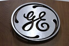 In this Thursday, Jan. 16, 2014, photo, a General Electric logo is displayed on a kitchen appliances in a H.H. Gregg store in Cranberry Township, Pa. General Electric Co. reports quarterly financial results before the market opens on Friday, Jan. 17, 2014. (AP Photo/Gene J. Puskar)