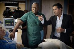 This undated image released by TNT shows Ving Rhames portraying Dr. Jorge Villanueva, left, and Executive Producer Dr. Sanjay Gupta on the set of