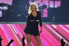 "FILE - This May 19, 2013 file photo shows Christina Aguilera performing at the Billboard Music Awards in Las Vegas. Aguilera is planning to have an entire brass horn section to back her up, and a special set list for Friday night's show during Jazz Fest, including ""Lady Marmalade,"" the Patti LaBelle song she helped remake into a hit years ago. (Photo by Chris Pizzello/Invision/AP, File)"